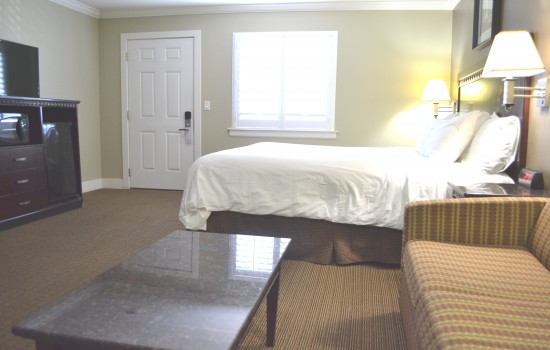 King Suite With Seating Area And Entertainment Center
